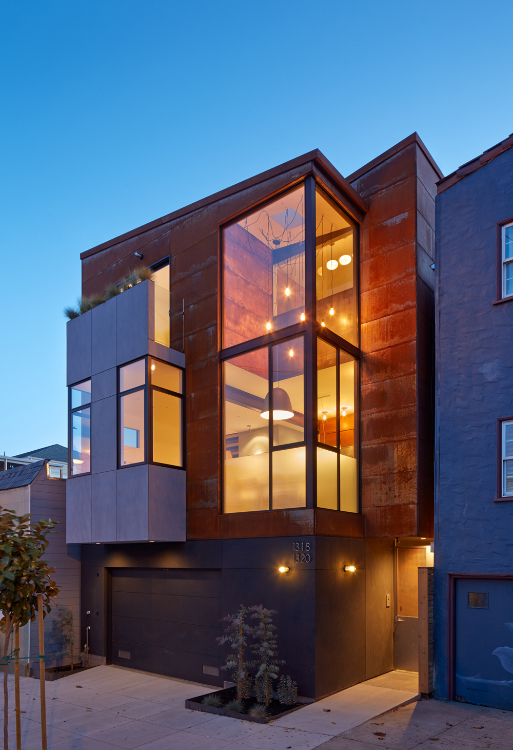 Steelhouse1: a new, ground-up three story home built at the front of the lot.